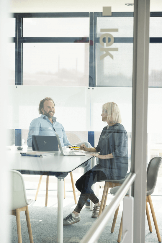 Man and woman meeting in office